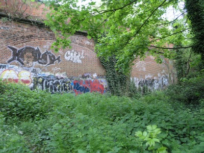 The bricked up archway of Bunns Lane bridge